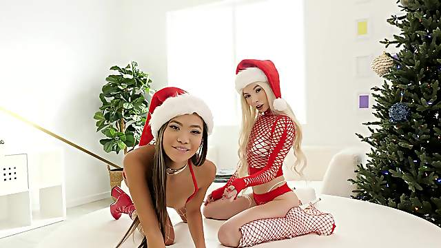 Kenzie Reeves and a sexy Asian share cock on Christmas during anal threeway