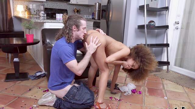 Curly haired ebony with petite forms, home interracial