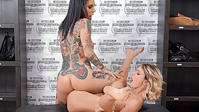 Tattooed MILF shares the pussy action with her lesbian friend
