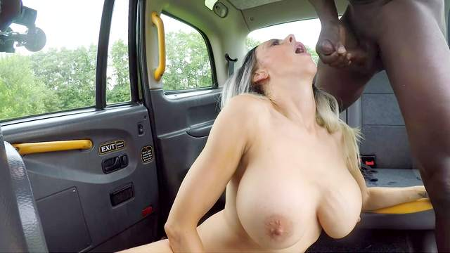 Interracial sex in the car with Jess Scotland licking black balls