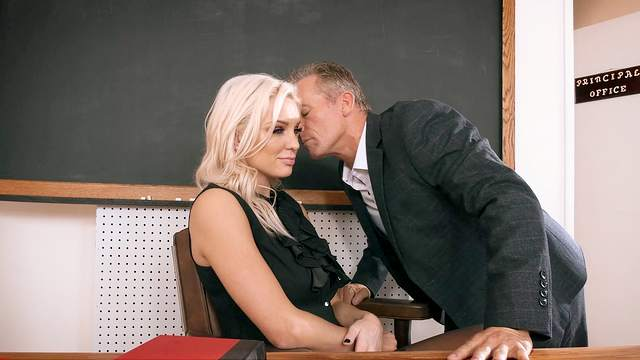 Female principal welcomes one of the male teachers for intimate relations in her office