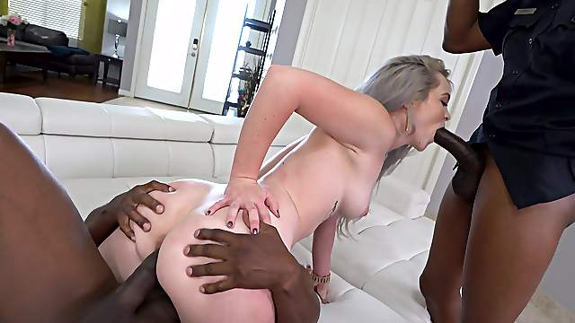 Petite honey feels a double dose of BBC ramming through her tiny holes